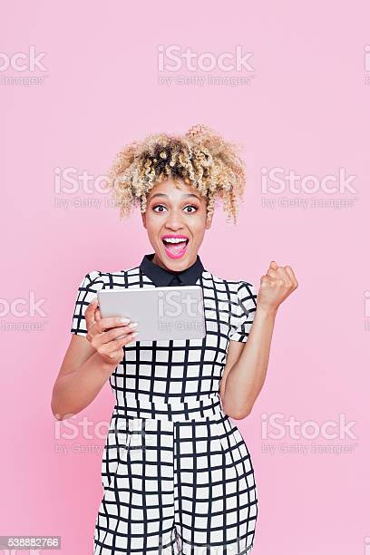 Funky Afro American Woman Using A Digital Tablet Stock Photo - Download Image Now