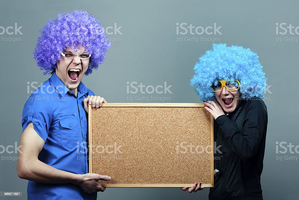 funky boy and girl with cork board royalty-free stock photo
