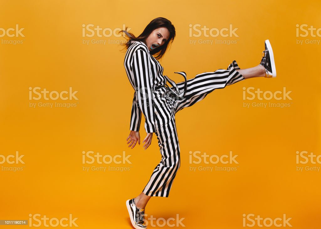Funky female on orange background stock photo