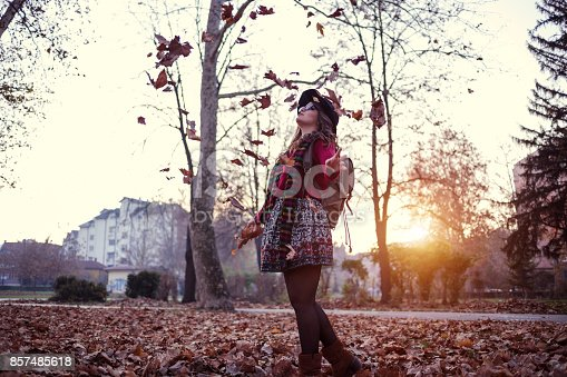 469211680 istock photo Funky Girl In Autumn Park 857485618