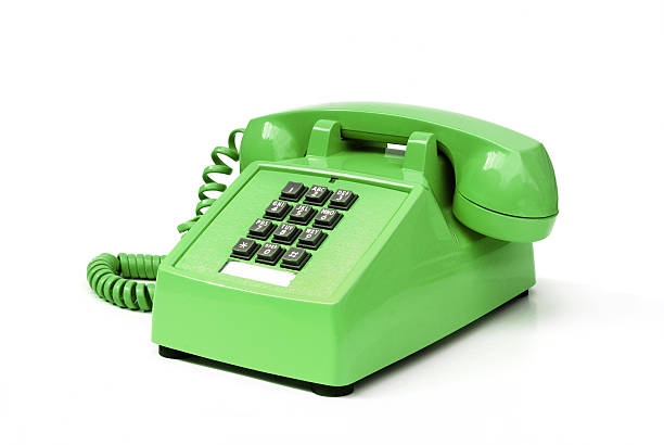 Funky green vintage pushbutton phone stock photo
