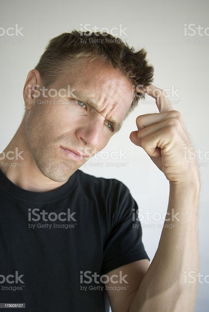 Funky Guy Scratches Head in Confusion royalty-free stock photo