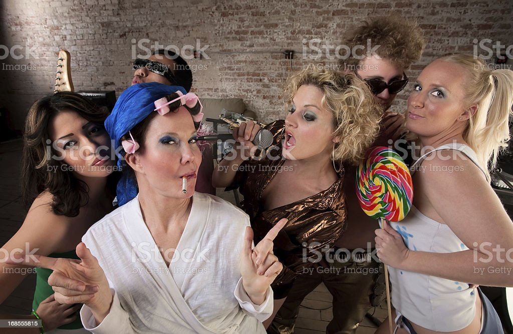 Funky housewife with rowdy group royalty-free stock photo