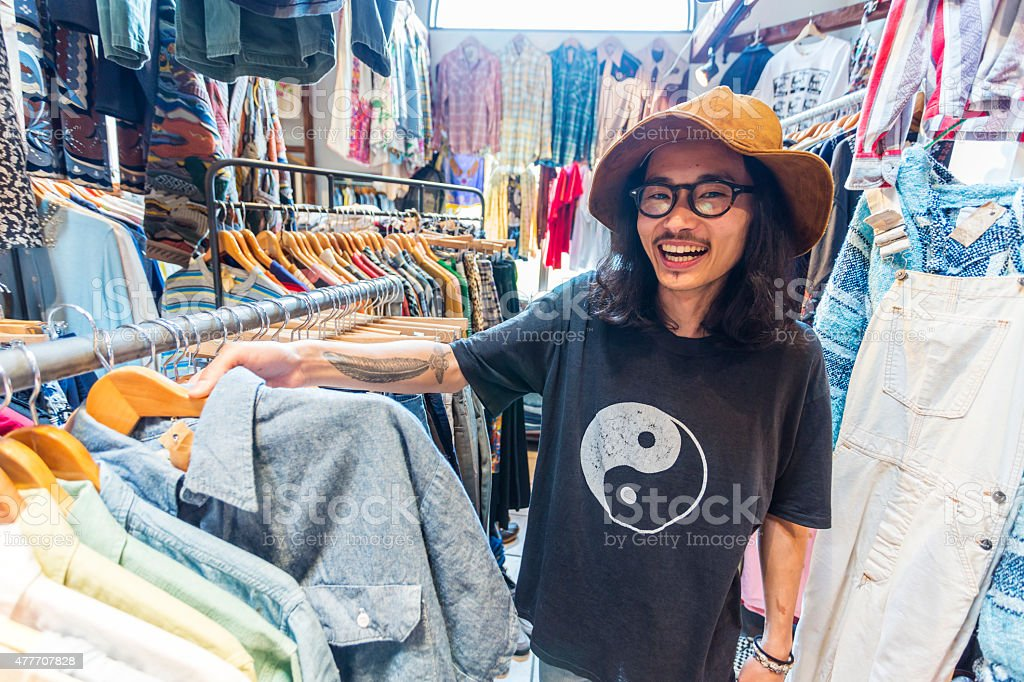 Funky Japanese Businessman in Clothing Store stock photo