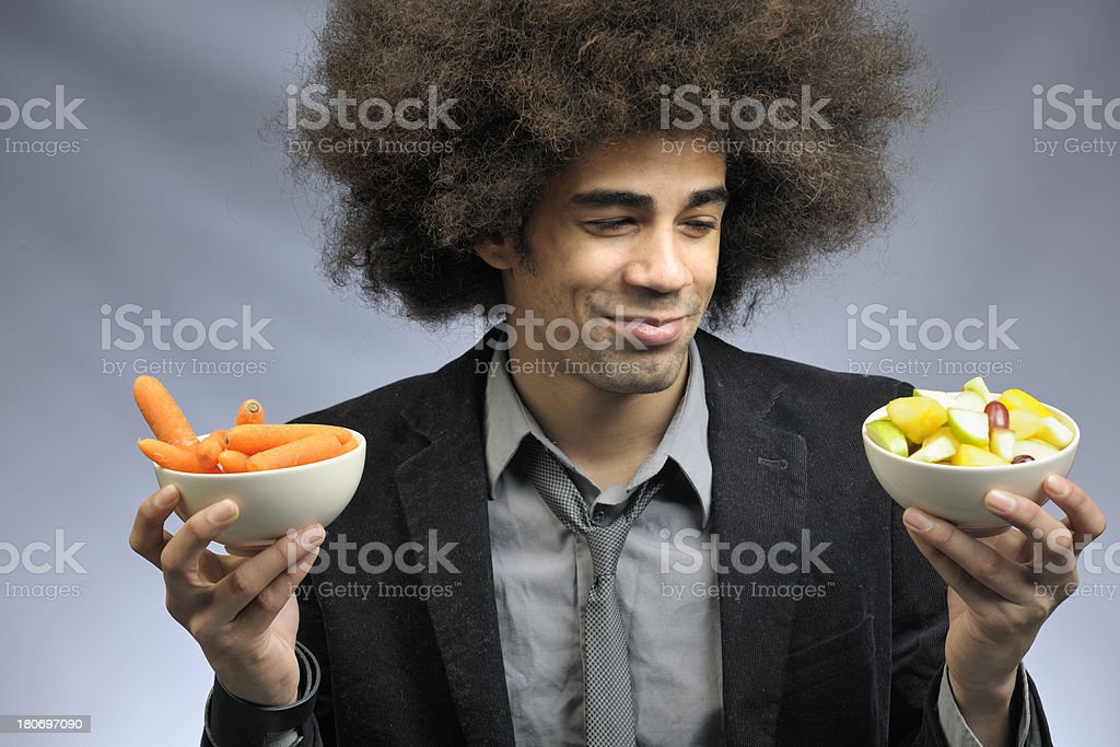 funky man holding bowls with healthy food royalty-free stock photo