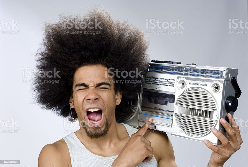 funky man singing to music on portable radio royalty-free stock photo