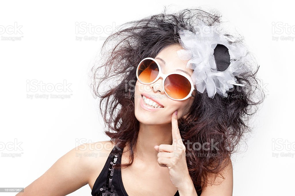 Funky, quirky, eccentric young chinese woman with big curly hair royalty-free stock photo
