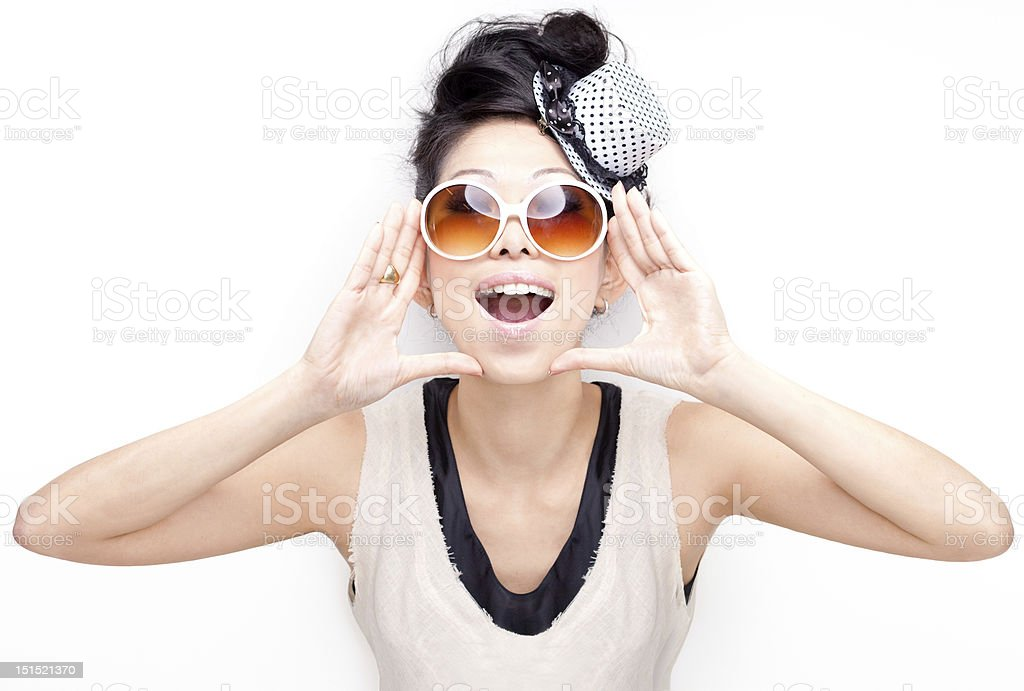 Funky, quirky, excited happy chinese woman yelling, shouting, screaming attention stock photo