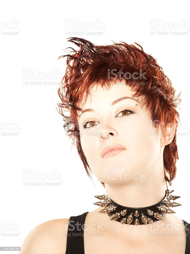 Funky redhead wearing spiked collar royalty-free stock photo