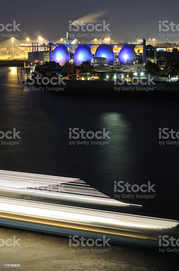 funky tanks and passing ferry royalty-free stock photo
