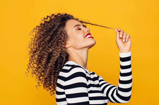 Funky young girl against yellow background