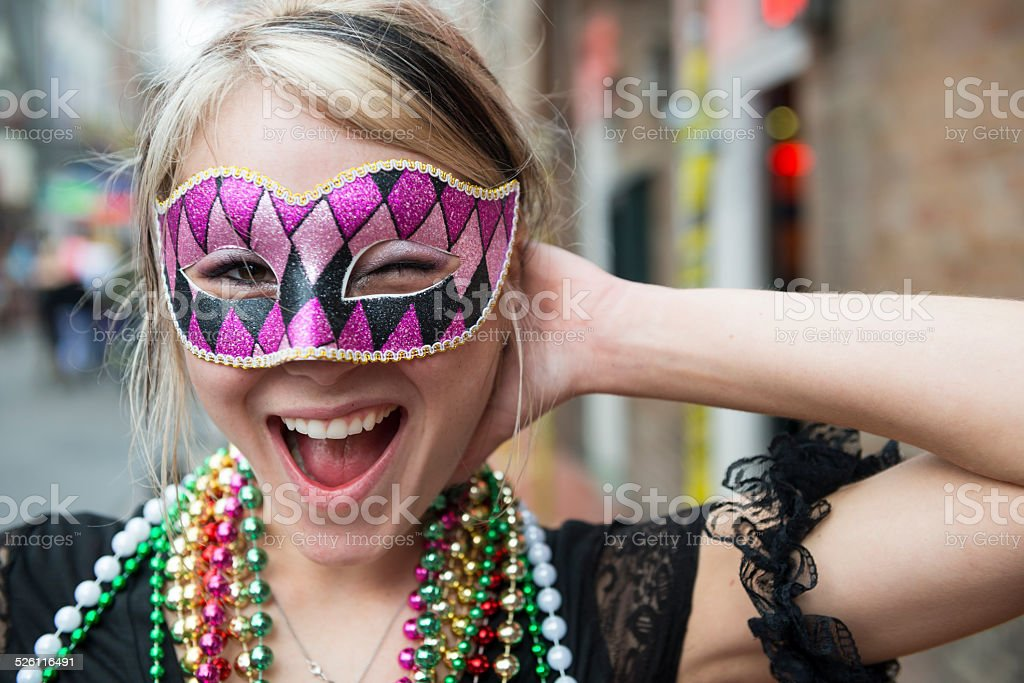 Fun-loving young woman at Mardi Gras in New Orleans Louisiana stock photo