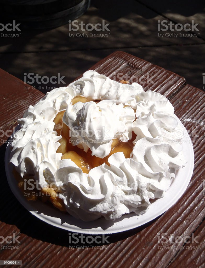 Funnel Cake enjoyed at a picnic table in a park stock photo