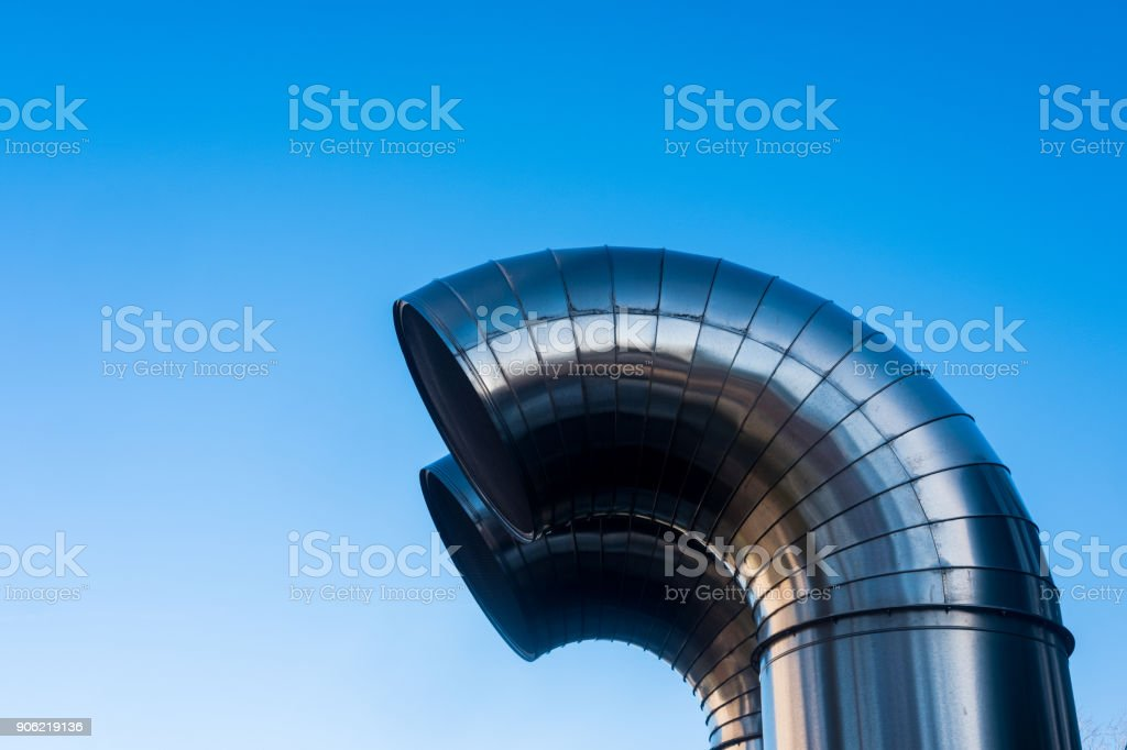 Funnel ventilation ducts on a modern building,  blue sky stock photo