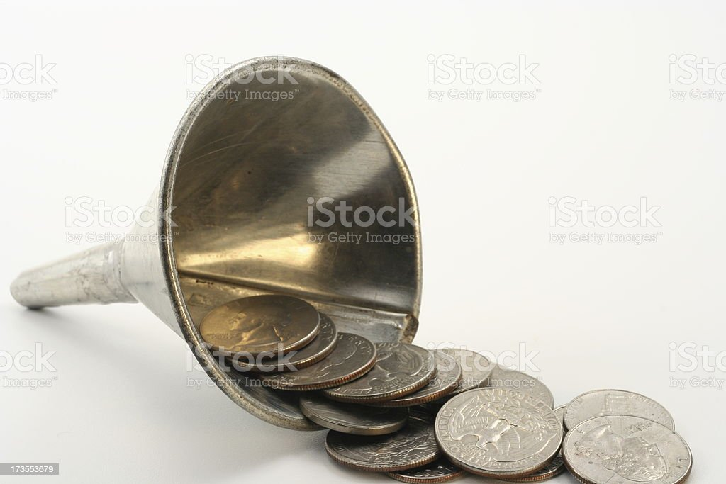 Funneling Coins stock photo