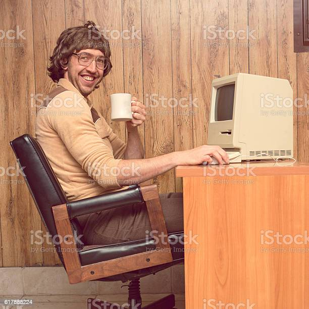 Funny 1980s computer man at desk with coffee picture id617888224?b=1&k=6&m=617888224&s=612x612&h=s4fmokupzsa2uonf5mtnx95kmp wydvsbc0jygljnvm=