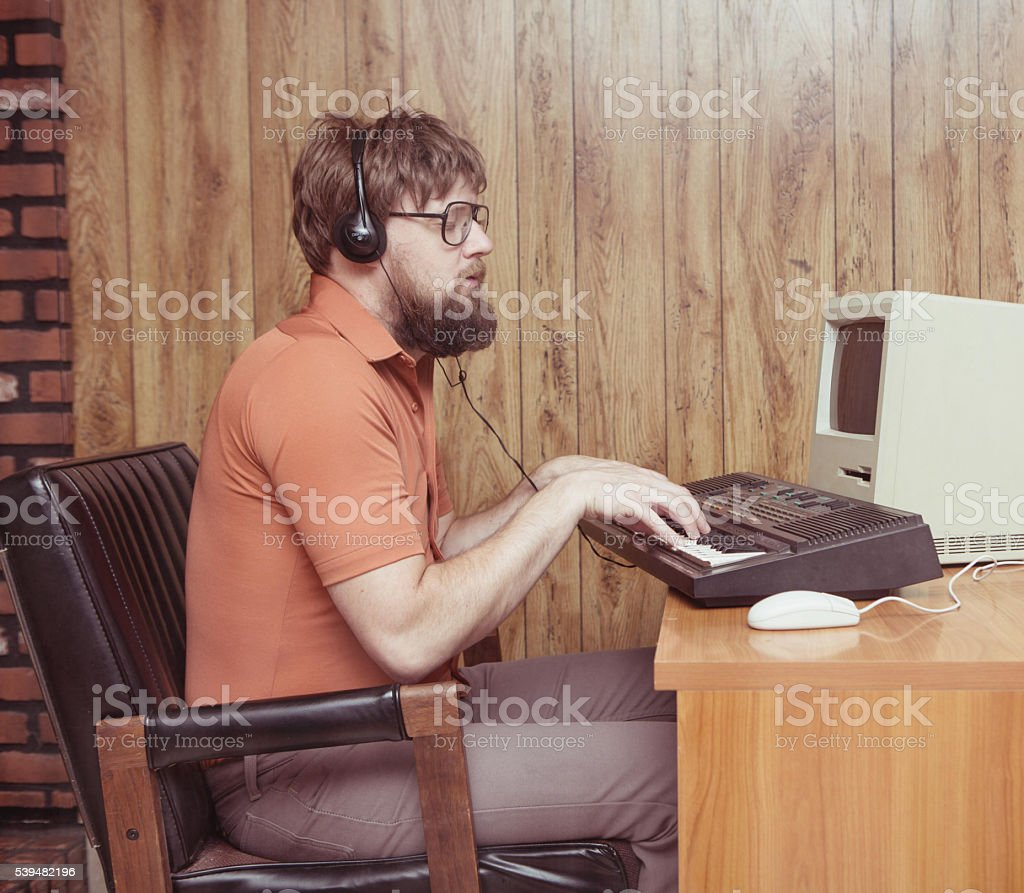 Funny 1980s man playing synthesizer DAW stock photo