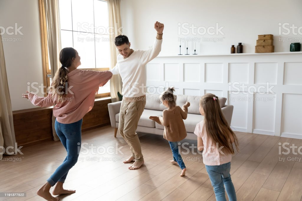 Funny Active Parents And Children Daughters Dancing In ...