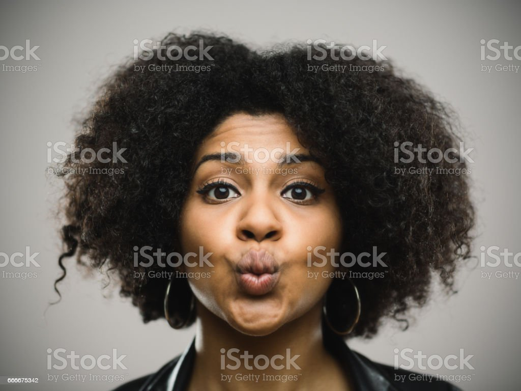 Funny afro american woman against gray background stock photo