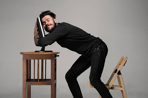 funny and crazy man using a computer - nerd stock photos and pictures