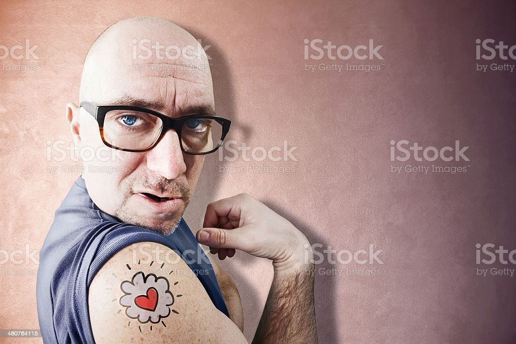Funny and ugly Latin Lover shows his tattoo stock photo