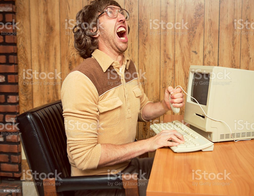 Funny angry 1980's office worker stock photo