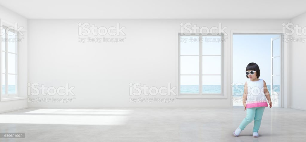 Funny Asian Child Girl With Sunglasses In Empty Sea View Kids Room Of Modern Beach House