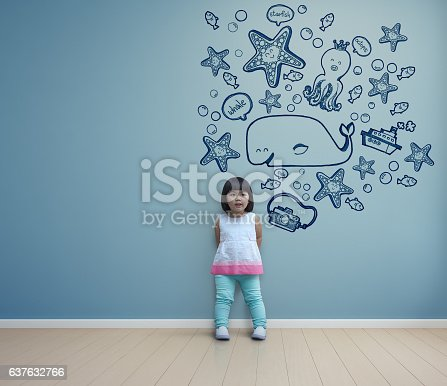 istock Funny asian child playing in blue room at home 637632766