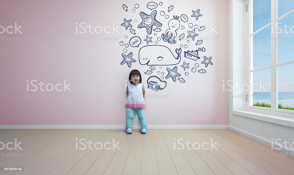 Funny asian child playing in pink room of beach house stock photo