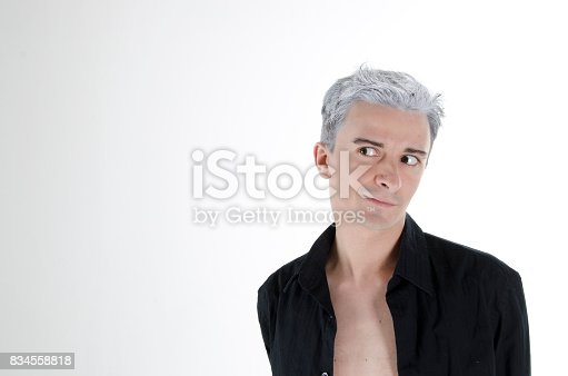 661896674 istock photo Funny attractive guy with gray hair. 834558818