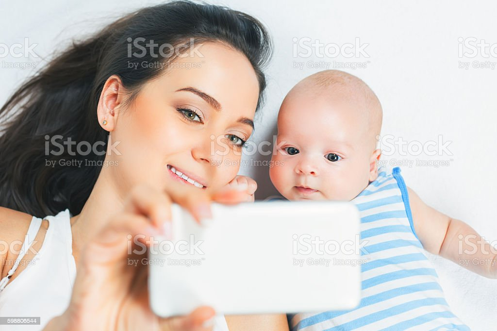 Funny Baby And Mother Make Selfie On Mobile Phone Stock Photo Download Image Now Istock