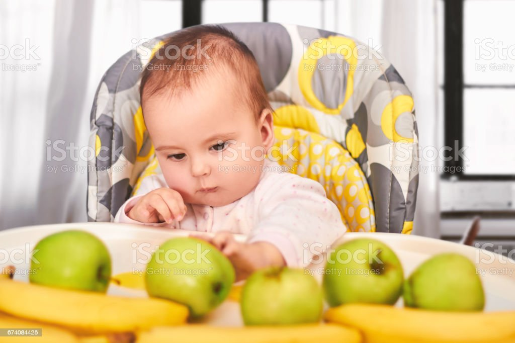 funny baby girl sitting in Chair for babies royalty-free stock photo