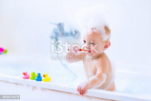 520441939 istock photo Funny baby in bath 520414473