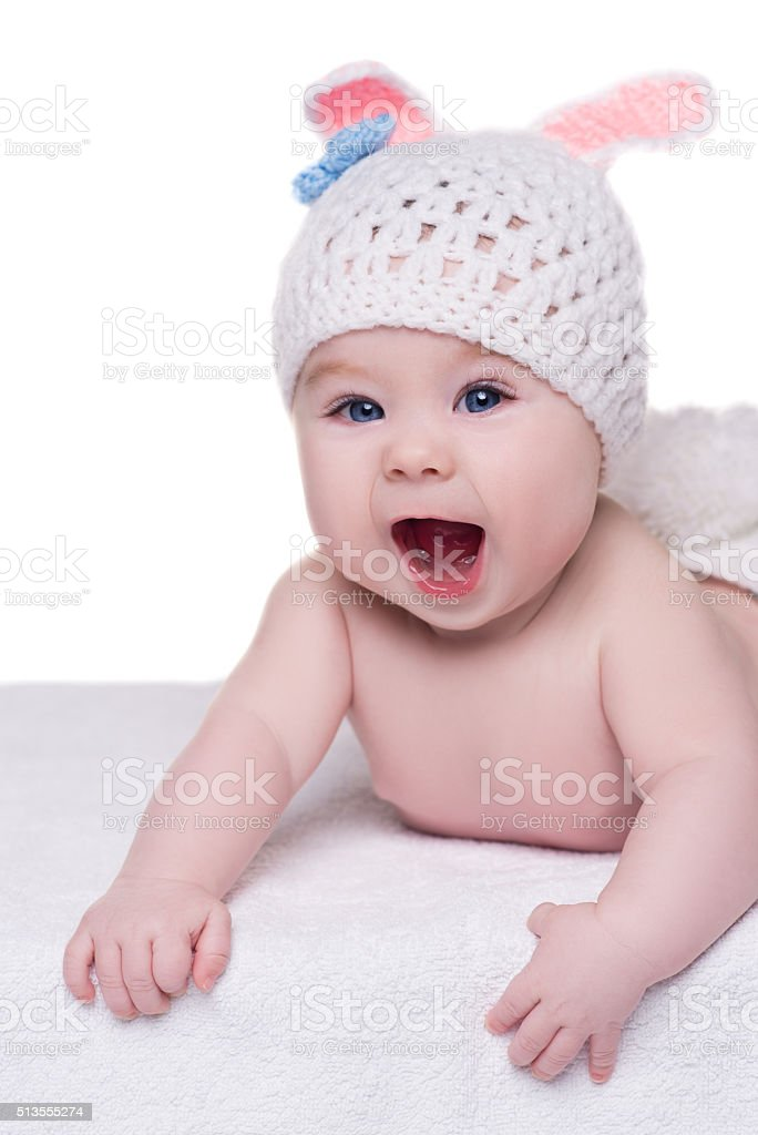 f508e495e Funny Baby In White Knitted Hat With Ears Bunny Crying Stock Photo ...