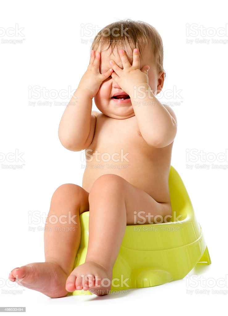 Funny baby on potty stock photo