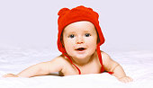 Funny baby on the bed