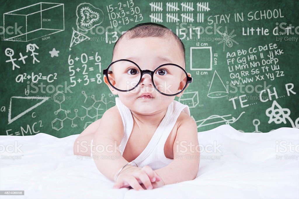 Funny baby with glasses and a doodles background stock photo