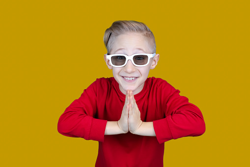 funny baby with kids 3d movie glasses on yellow background