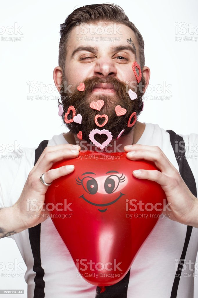 Funny bearded man with hearts Valentine's Day. - foto stock