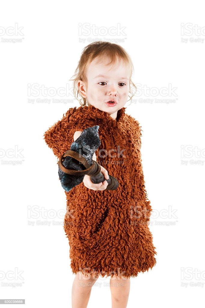 Funny boy caveman with dirty face holding an ax. stock photo