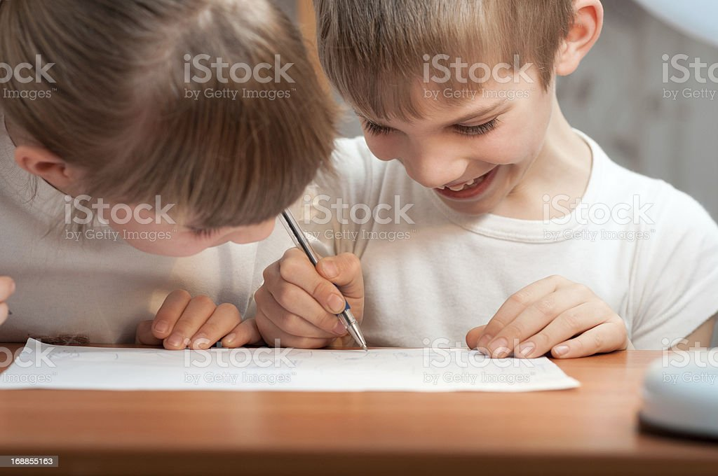 funny boy draws a pen on paper royalty-free stock photo