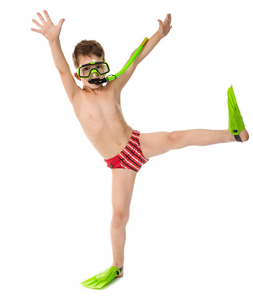 Funny boy in diving mask and flippers Funny boy in diving mask and flippers, isolated on white diving flipper stock pictures, royalty-free photos & images