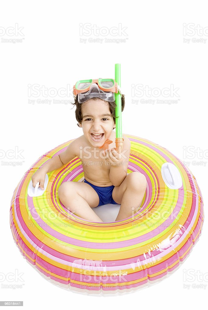 Funny boy in inflatable raft royalty-free stock photo