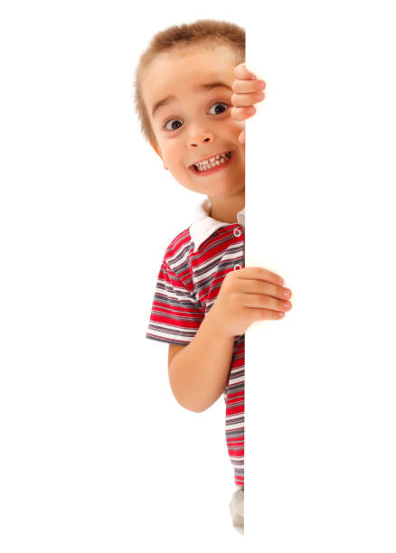 Funny boy mime scary expression behind wall stock photo