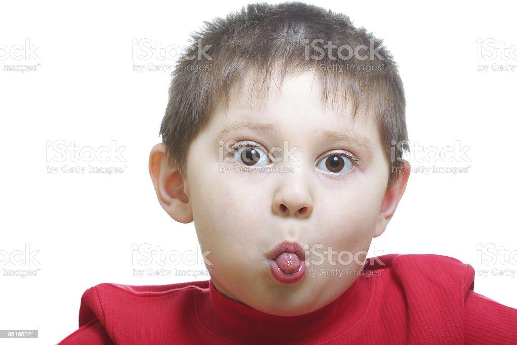 Funny boy showing tongue royalty-free stock photo