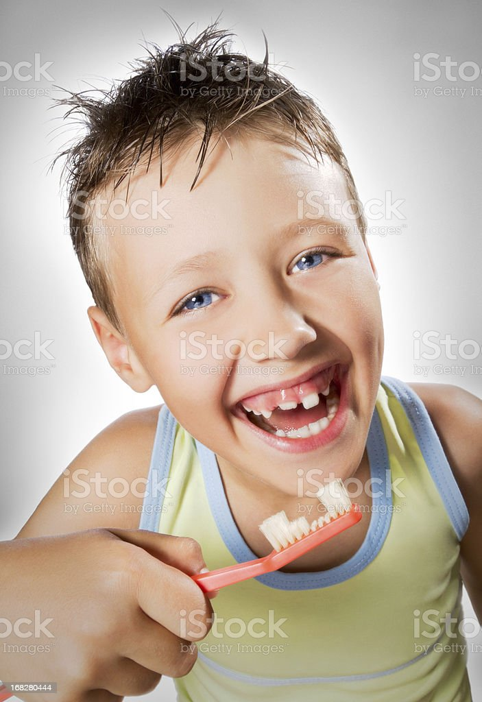 funny boy with uneven toothbrush stock photo