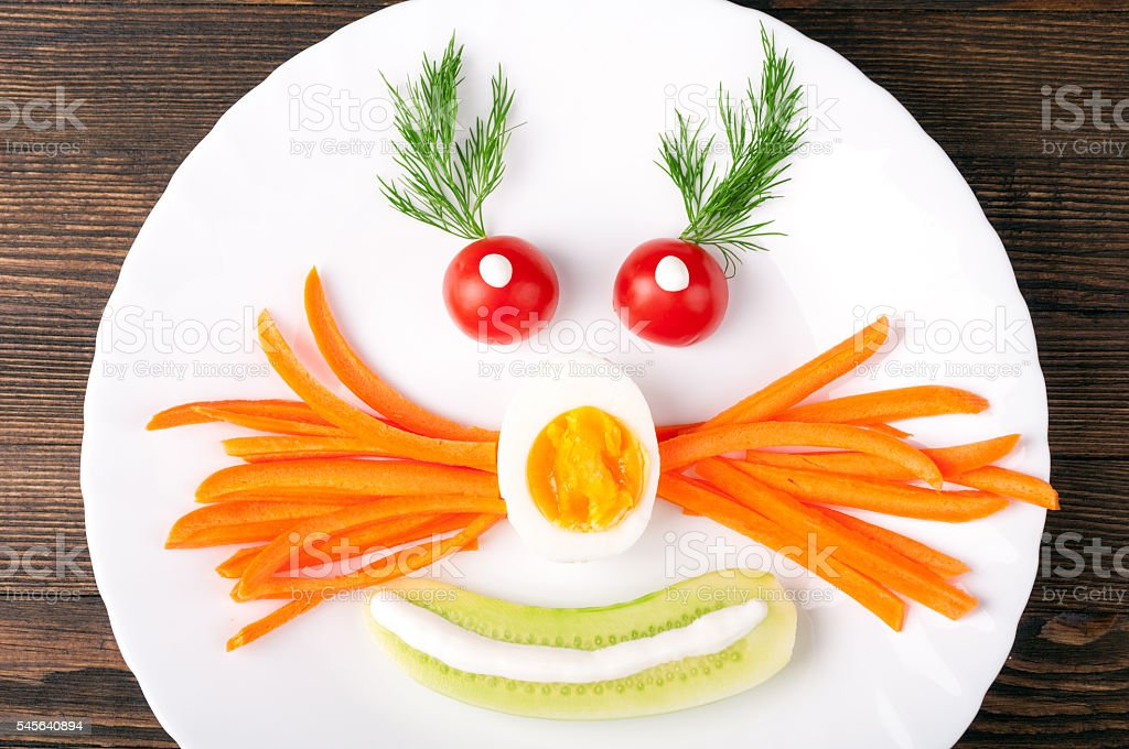 Funny breakfast or lunch for kids with vegetables, egg and herbs....