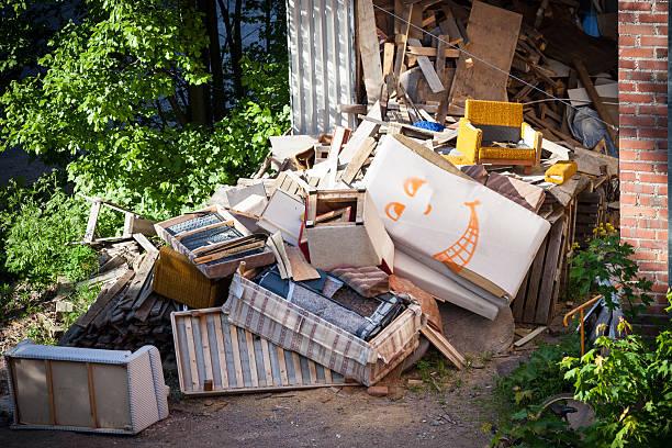 Funny broken furnitures trash pile stock photo