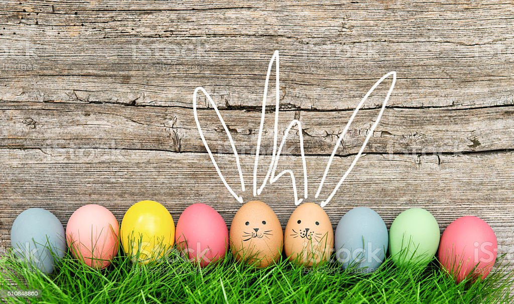 Funny bunnies easter eggs. Cute decoration stock photo