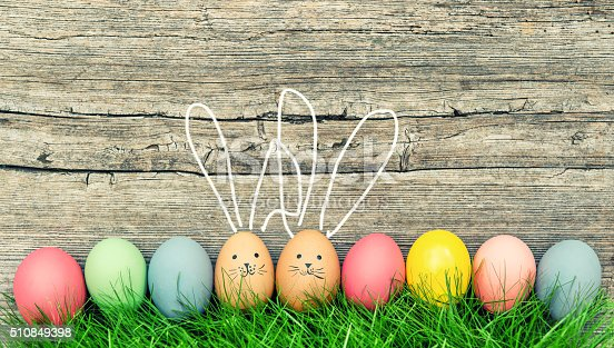 istock Funny bunnies easter eggs. Cute vintage toned decoration 510849398